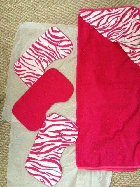 Hoodie blanket and burp cloths