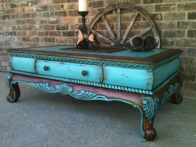 I purchased this coffee table from a local 2nd hand store, I added new life to it by highlighting the ornate raised details with cool & clear turquoise paint & dark walnut stain, I Love the way it turned out