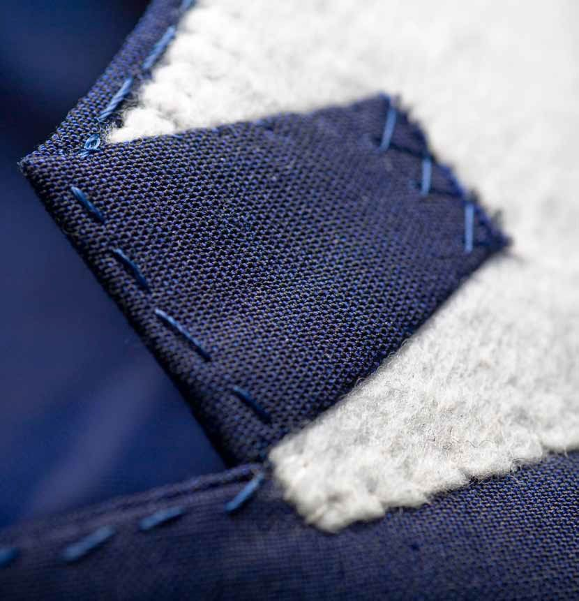 "UNDERSIDE OF COLLAR: ""We lengthen the jacket's collar so that we can turn back the ends. this hides the [contrasting] felt from view when the suit is worn. the collar points are secured with fine hand-stitching.'"