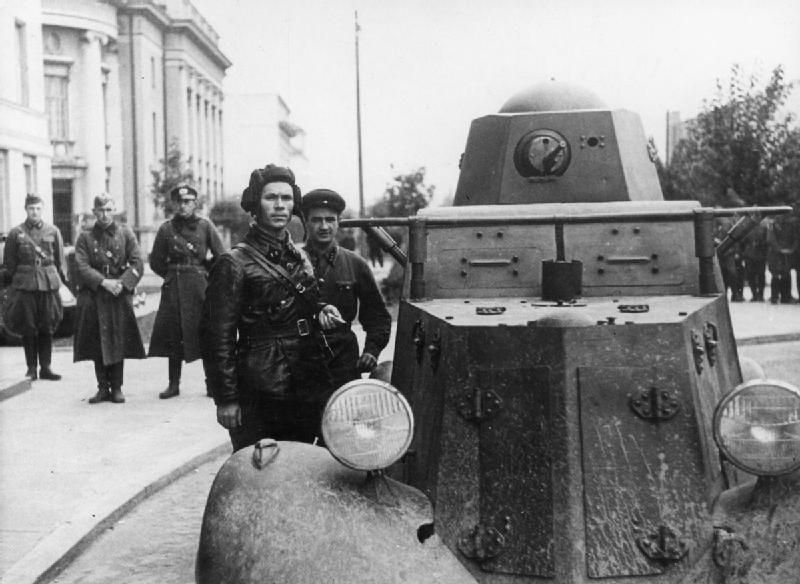 Red Army troops standing beside a BA-I armoured car in the Polish - ba stands for