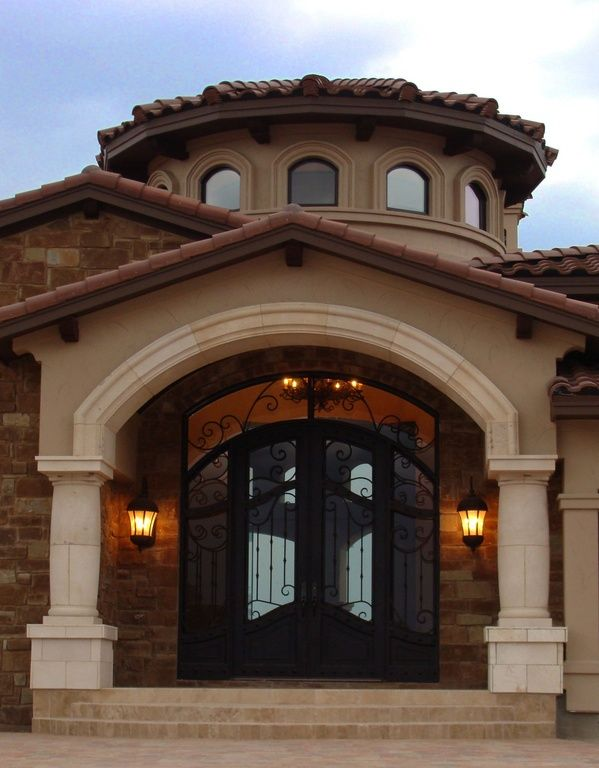 Mediterranean front door with french doors arched window for Transom windows exterior
