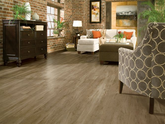 Light Grey Vinyl Flooring In The Living Room With Exposed Brick Walls Luxury Vinyl Plank Luxury Vinyl Flooring Vinyl Flooring