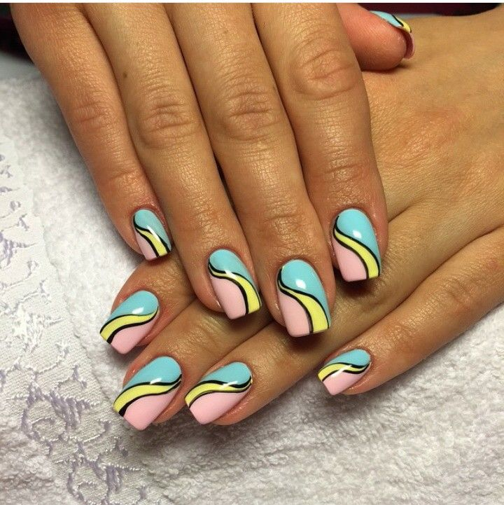 Blue, pink, and yellow pop art nails