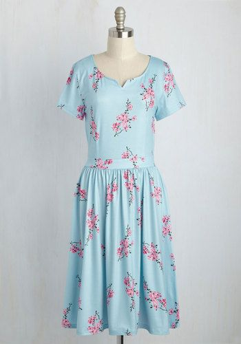 Business casual is a blast when you infuse your personality into your outfits. This sky blue dress, for instance, will show off your whimsy while remaining daring and demure. With a notched neckline, flattering waistband, and pink cherry blossom print, this knit frock will earn high marks in the office!