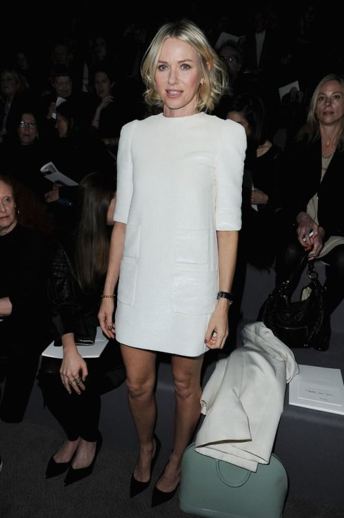 Naomi Watts sat front row at the Louis Vuitton  show in Paris in a mod white dress with cute pocket details, completed with black pumps, a white coat, and a minty Louis Vuitton bag.