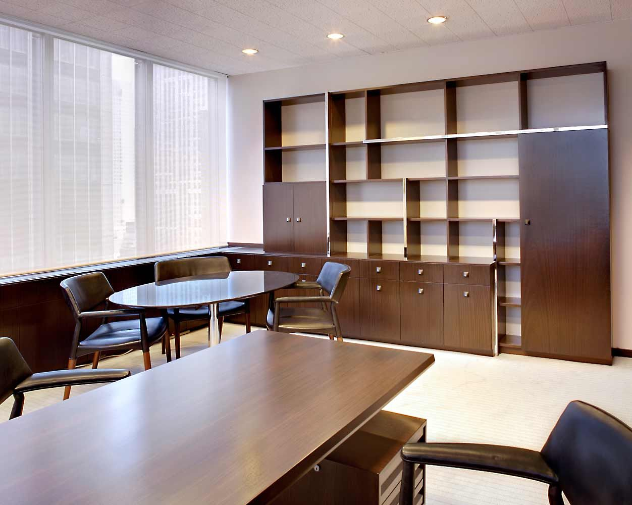 For large empty room wall book shelf and small conference table