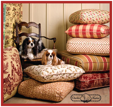 Designer Charles Faudreé's Cavaliers look perfet in his French Country home