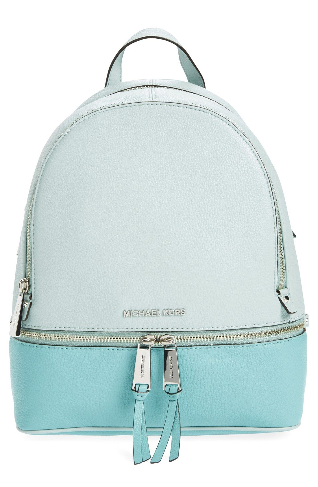 b10f3218da2b Adoring this leather backpack in shades of blue for a fun color-blocked look .
