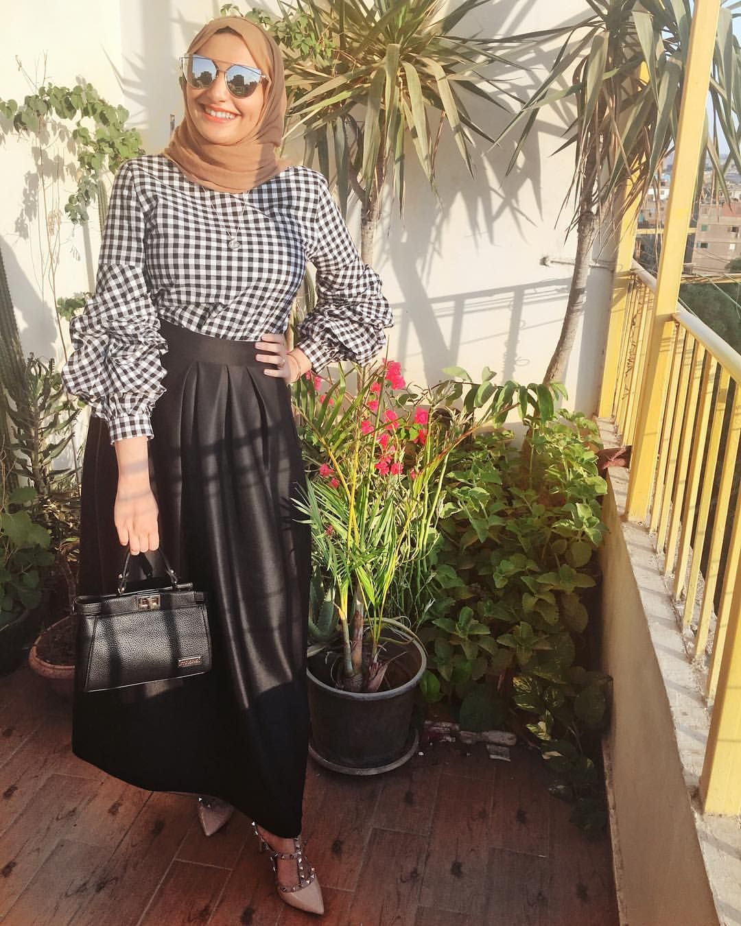 16f554c85 black and white gingham blouse and black pleated circular skirt - beige  studded pumps- beige nude scarf - silver shades hijab - hijab street  fashion - hijab ...