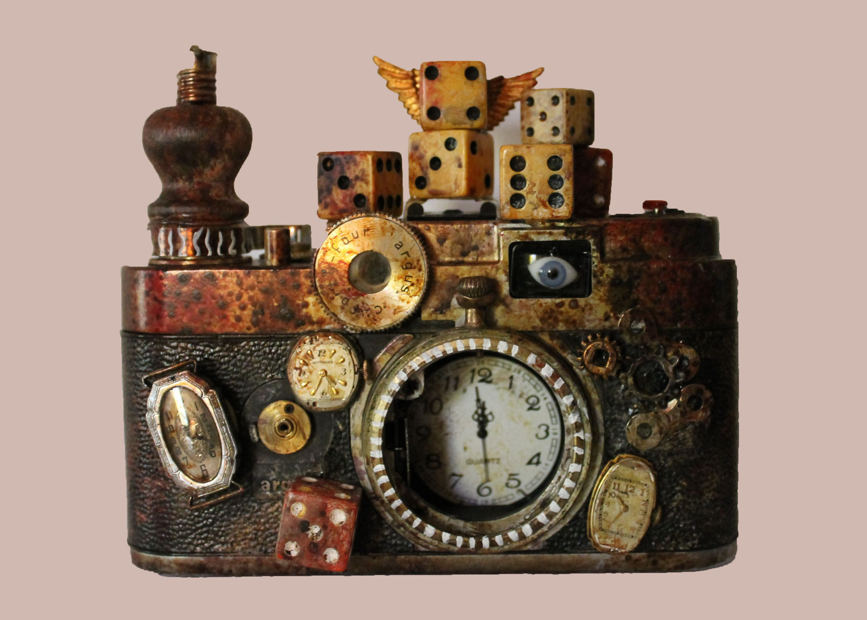 A Snapshot in Time - mixed media assemblage of camera body, watch parts, lucky dice