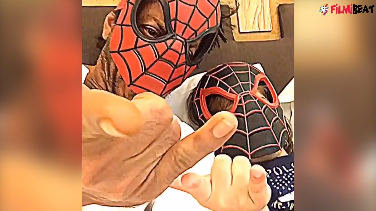 Shah Rukh Khan shared a video of him lying next to AbRam with Spiderman masks…