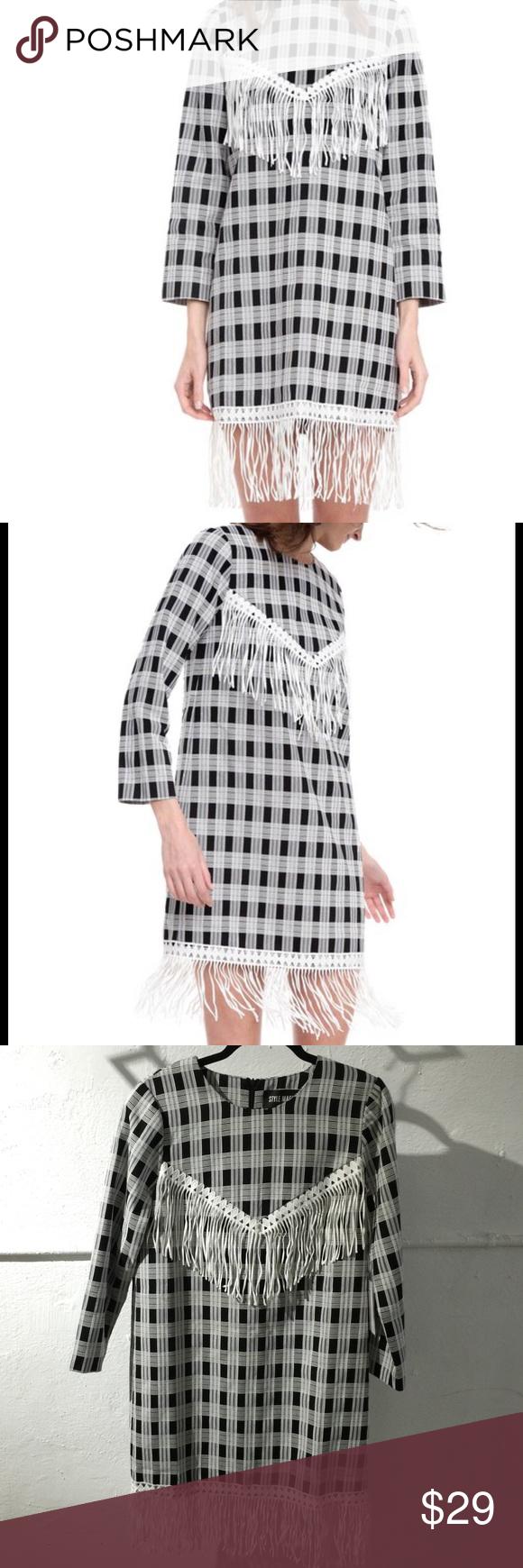 Graphic print midi dress Black and white long sleeve, graphic print midi dress with white fringe on hem and front detail. Zipper on back. Style Mafia Dresses Midi