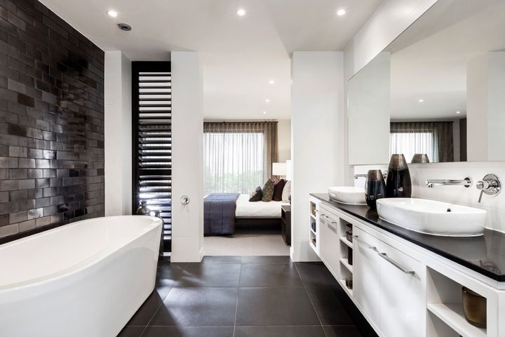 A master bedroom ensuite with free standing bath, dreamy!  Tile in 2019  Open bathroom