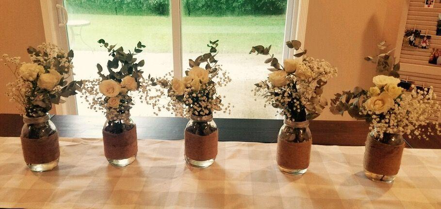 Mason Jar Eucalyptus Baby S Breath And White Roses Centerpiece Rose Centerpieces White Roses Babys Breath