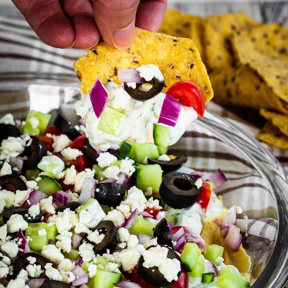 This tasty Greek 7 layer dip makes the perfect appetizer or snack. Quick and easy to make and full of flavour, it's also healthier then most dips! #7layerdip This tasty Greek 7 layer dip makes the perfect appetizer or snack. Quick and easy to make and full of flavour, it's also healthier then most dips! #7layerdip