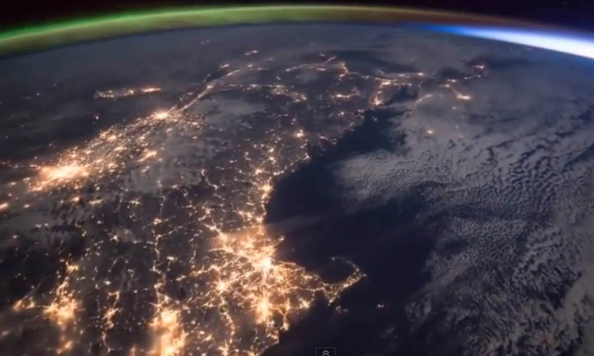 Nasa footage shot from the International Space Station shows the moment the Northern Lights, or aurora borealis, merges into a sunrise