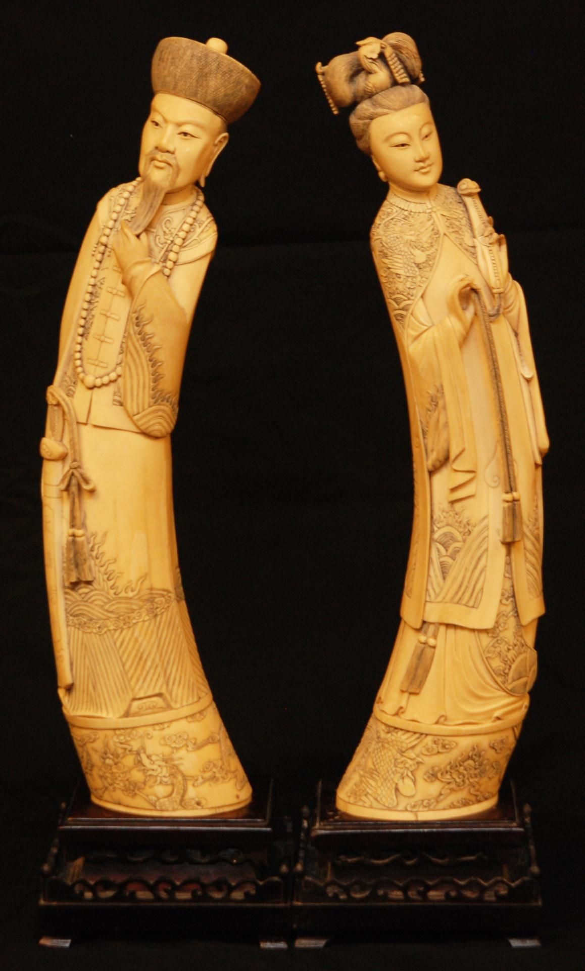 70efbb435fd5 Pair of large Chinese hand carved ivory Emperor and Empress tusk figures.  The empress is depicted holding beaded Ruyi scepter with tassel and having  relief ...