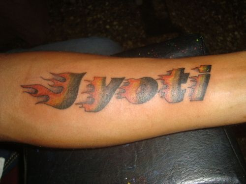 Name Tattoo On Arm Jyoti With Flames