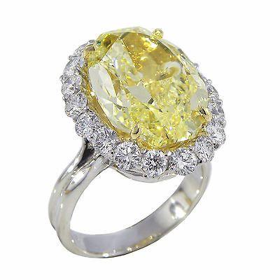 12.71 carat GIA Canary Yellow Diamond with 2.88cts Diamond Halo Ring