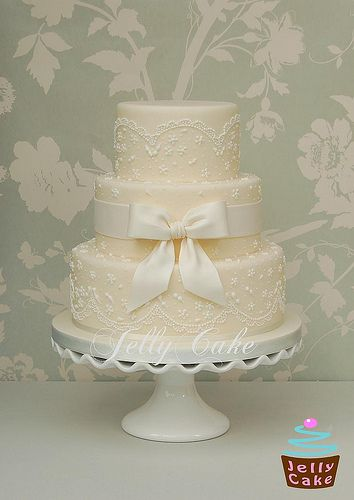 Ivory Lace and Bow Wedding Cake   Flickr - Photo Sharing!