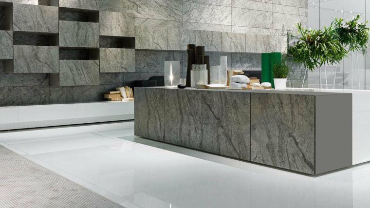 moderna ed originale cucina con pareti e isola realizzati in pietra ...