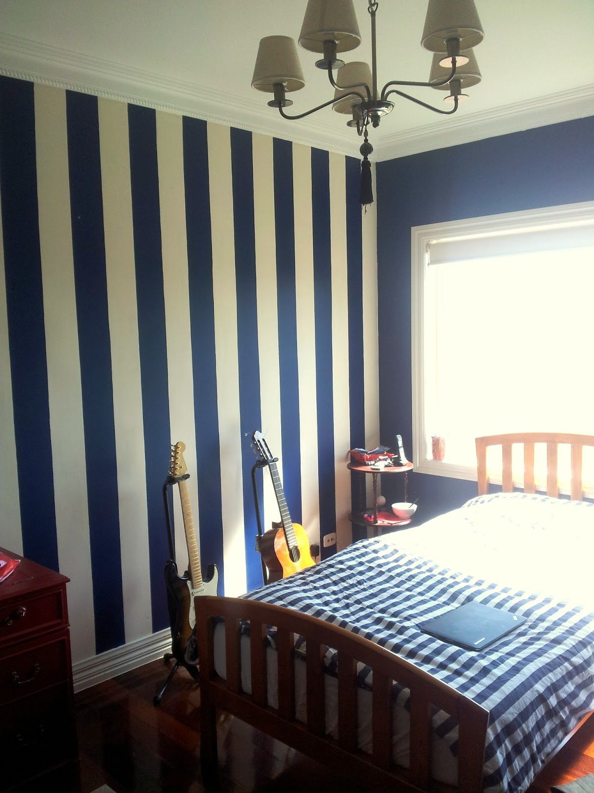 stripes in navy on one wall behind headboard Blue