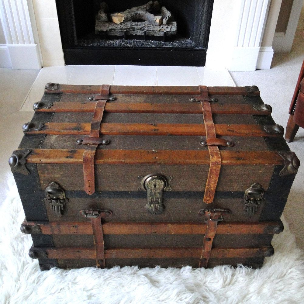 Reserved for eric large antique steamer trunk coffee table flat top slatted wood base casters Metal chest coffee table