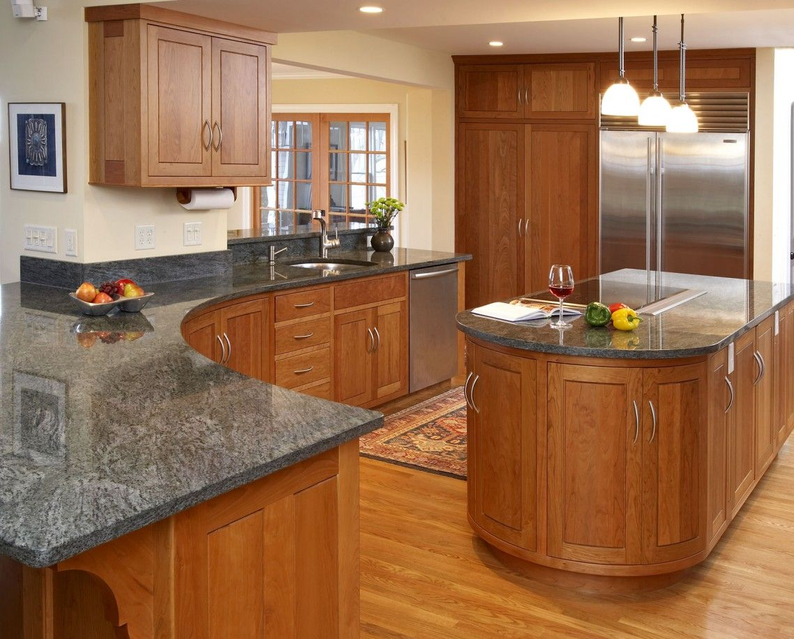 Dark grey countertops with natural oak cabinets google for Grey kitchen cabinets with red walls