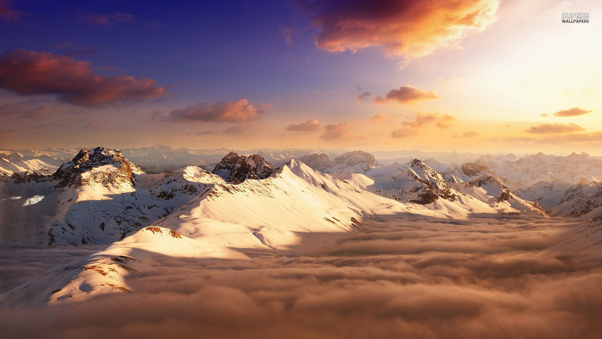 Snowy Mountain Peaks Above The Clouds Wallpaper 1920x1080 صور