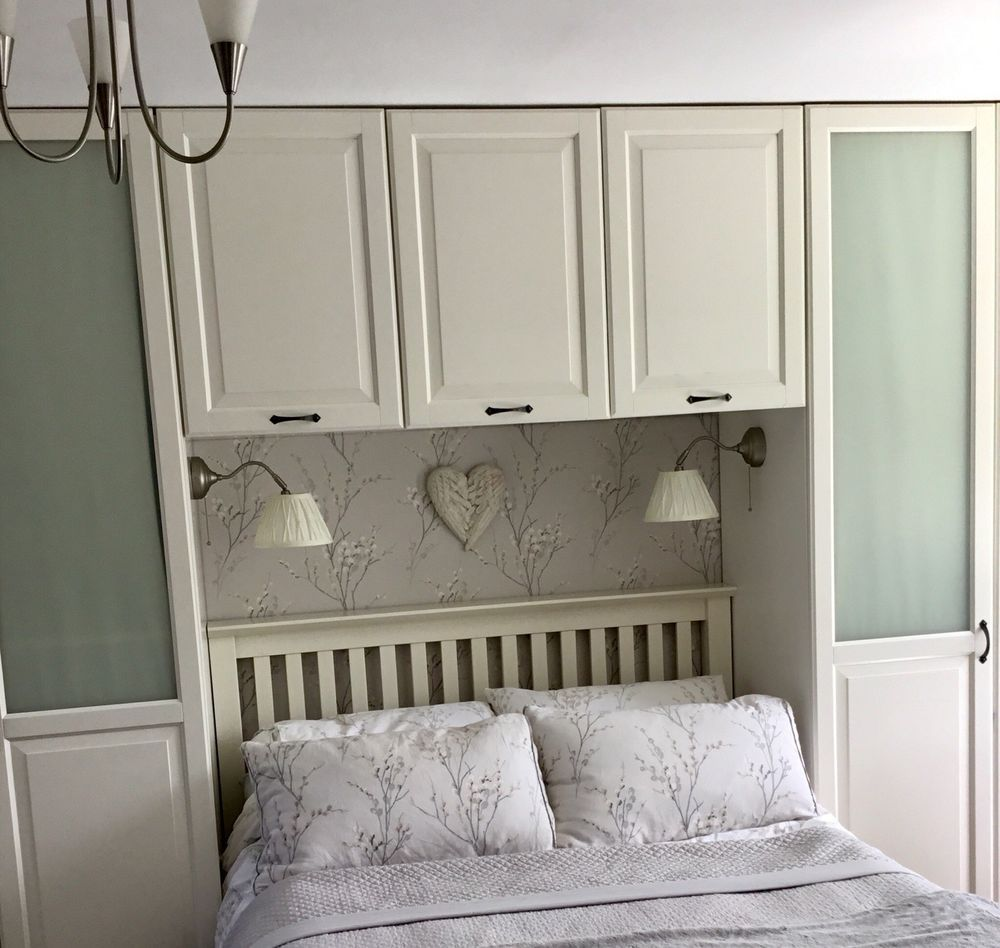 9 x single ikea wardrobes and matching over bed cupboards . The
