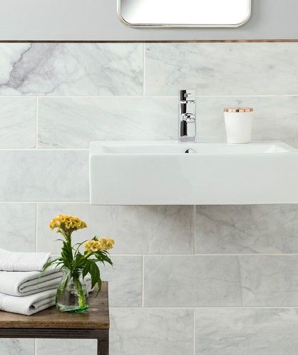 Bathroom Tiles Ennis marble look tiles on floor and wall, creating an illusion of depth