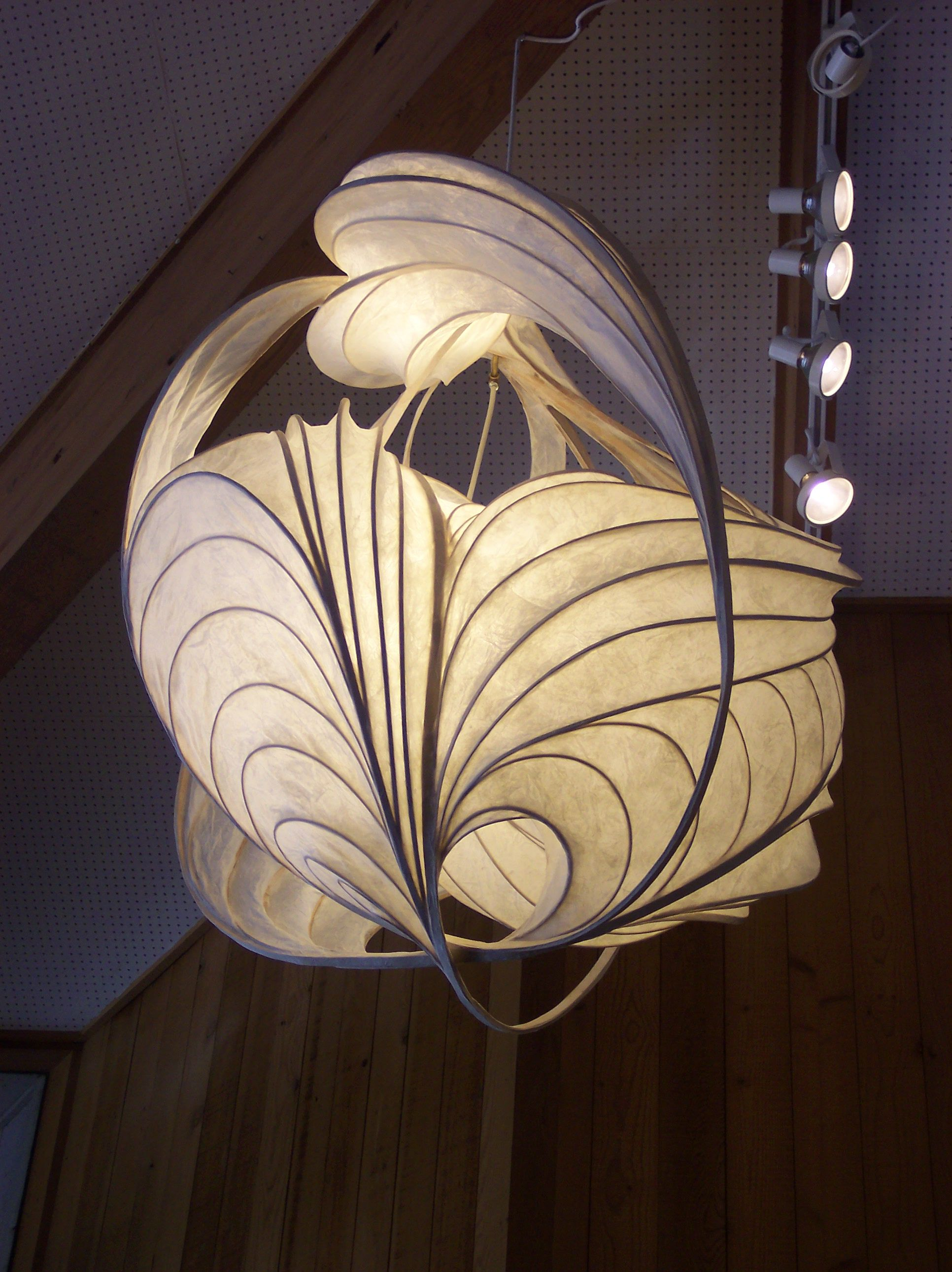 William Leslie lightsculpture made from thin strips of wood bent