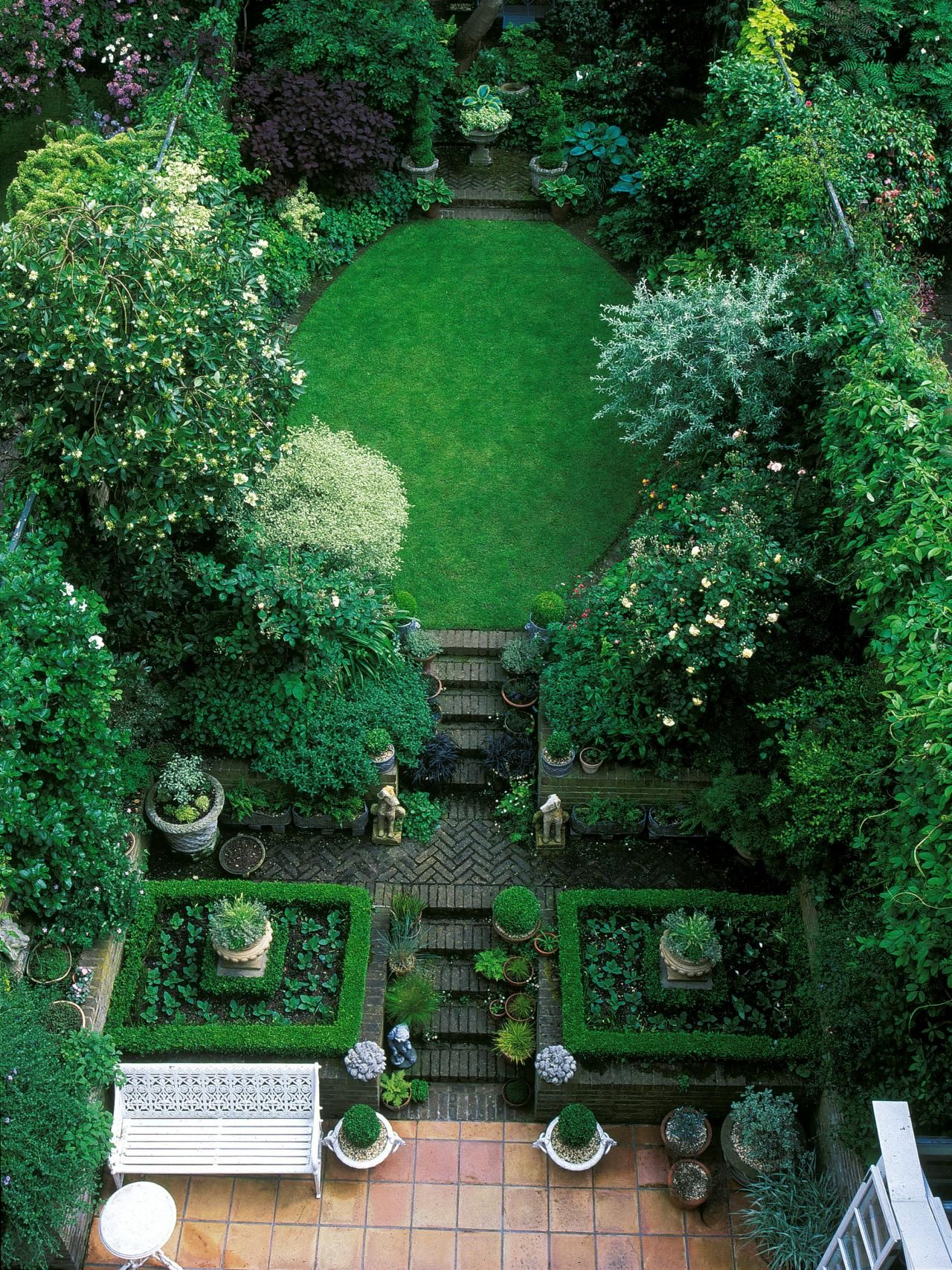 this oval lawn is set among luxurious greenery and multiple terraces