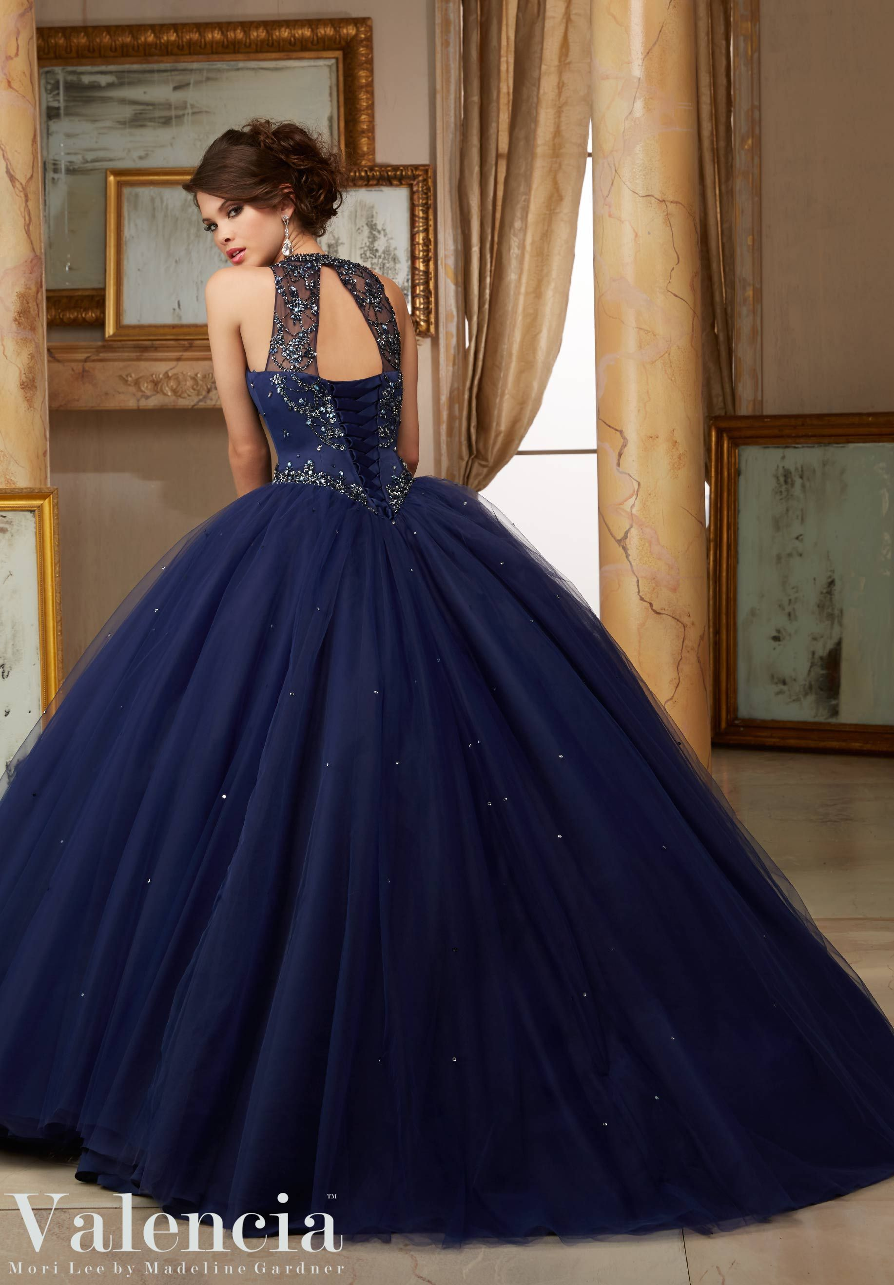Jeweled beaded satin bodice on tulle ball gown quinceañera dress