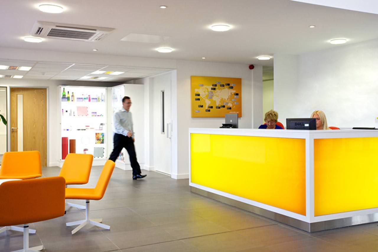 Yellow reception desk from for Bureau reception