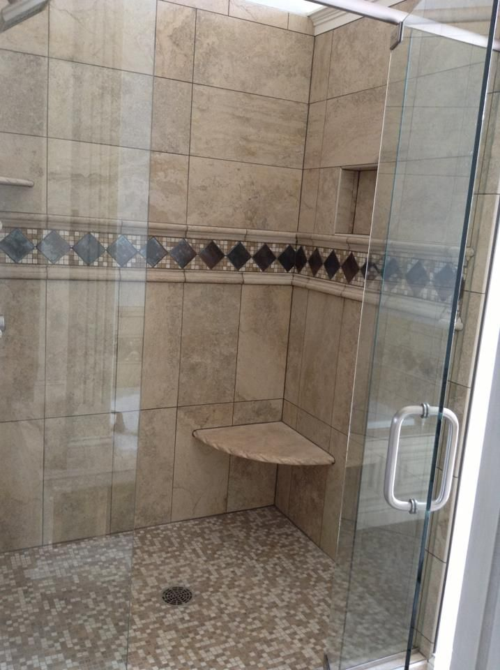 tile shower with 12x24 tile and deco