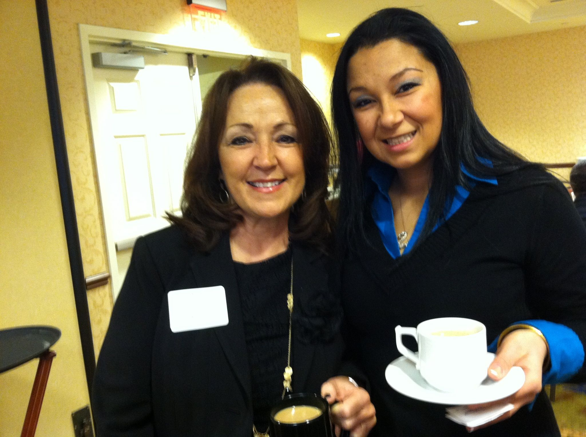 Kathy Caisse (Residence Inn Boston Westford) and Michelle Rattanavong (All Points Limousine)  networking at a Fidelity Bank Breakfast