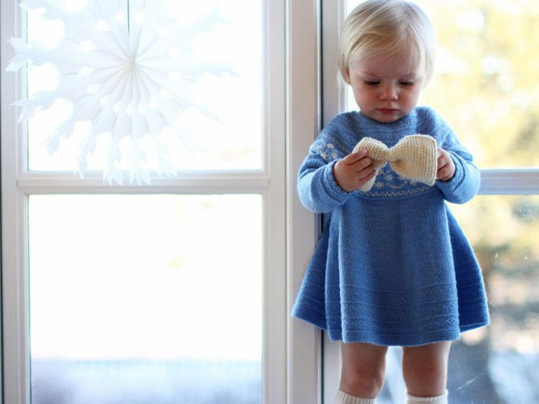 Knitted dress for baby