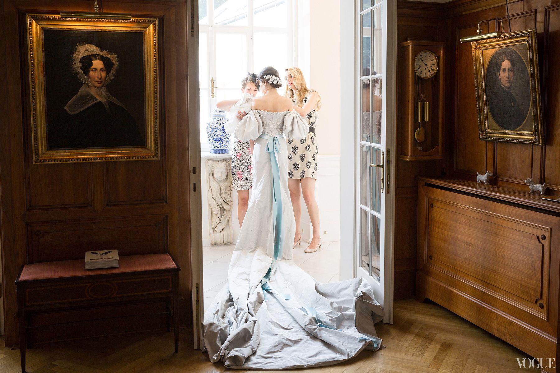 Catholic wedding dresses  Putting on the final touches before the Catholic wedding ceremony