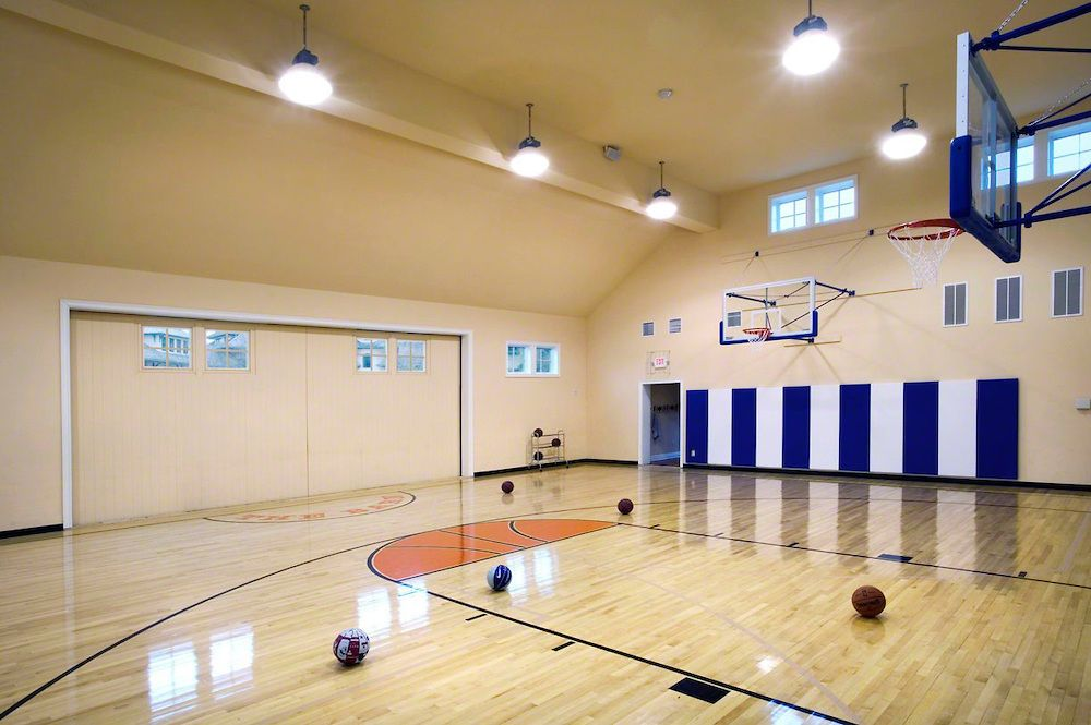 Residential Indoor Basketball Court With Hid Lighting Edgonline Home Basketball Court Indoor Basketball Court Indoor Sports Court