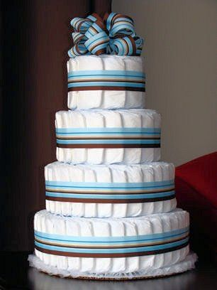 Diaper cakes are great centerpieces for any upcoming baby shower and they can be made smaller so that you can bring it to the hospital as a small welcoming gift. This would also be pretty with pink and brown