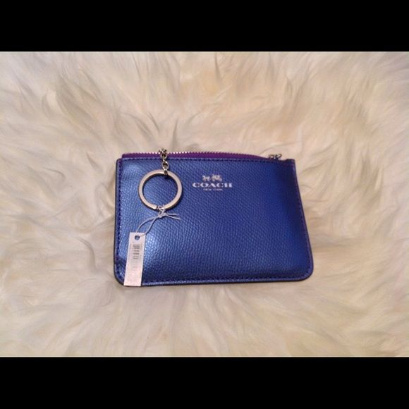 COACH KEY POUCH WITH GUSSET IN CROSSGRAIN LEATHER COACH KEY POUCH WITH GUSSET IN CROSSGRAIN LEATHER  LIGHT SILVER/PURPLE Details Crossgrain leather Zip closure, fabric lining 5 (L) x 3 3/4 (H) Coach Accessories Key & Card Holders