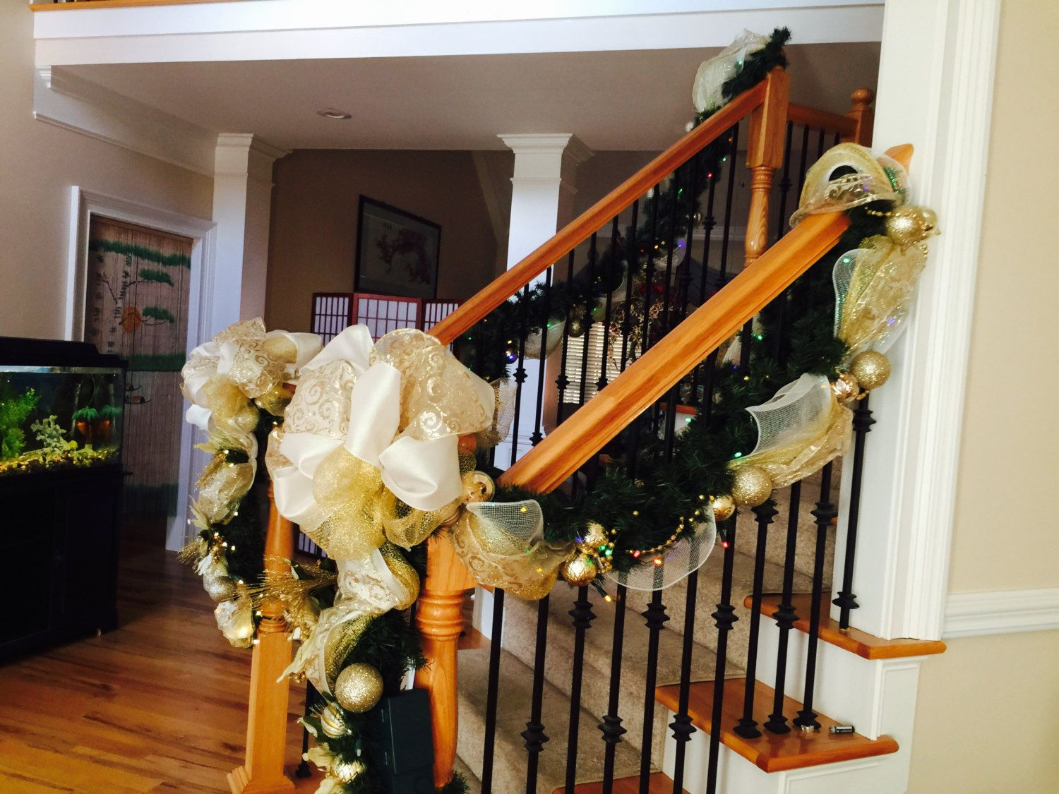 Christmas stairway garland 9 foot lighted swag mesh swag for How to decorate a banister