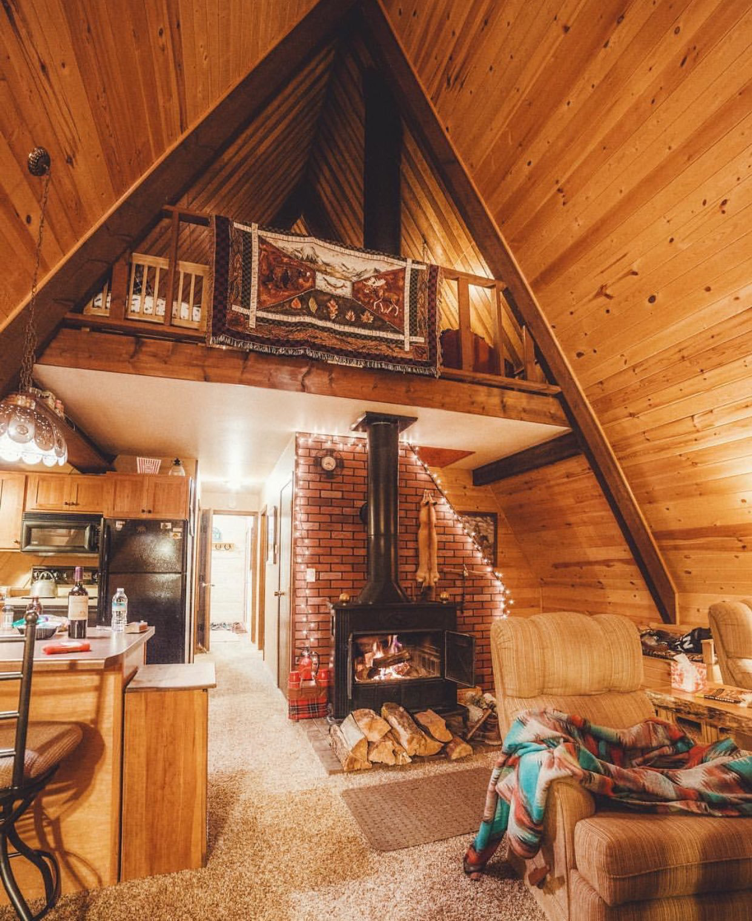 Lovely Wood Interior Of An A-frame Home With Wood Burning