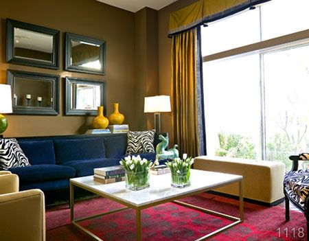 Triad The Red Rug Blue Sofa And Yellow Drapes Vases Make A Triadic Color Scheme These Contrasting Colors Create An Appealing Look In Living