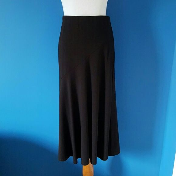 Ann Taylor Skirt Made in USA. Black Ann Taylor skirt. Elastic waist. Diagonal seam on front and back. 88% Rayon, 12% Spandex. 29 inches long. Midi length. Size S Petite Ann Taylor Skirts Midi