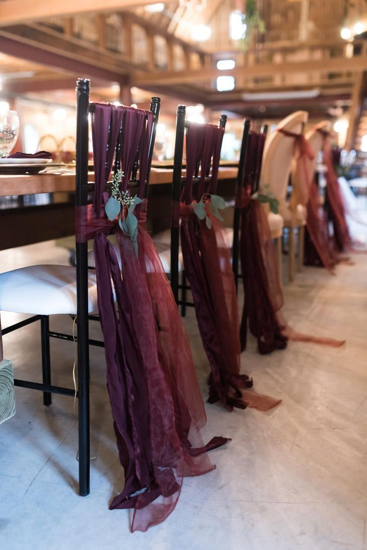 Wedding decor maroon  Maroon Fabric Tied on HeadTable Chairs MaroonWeddingIdeas  The