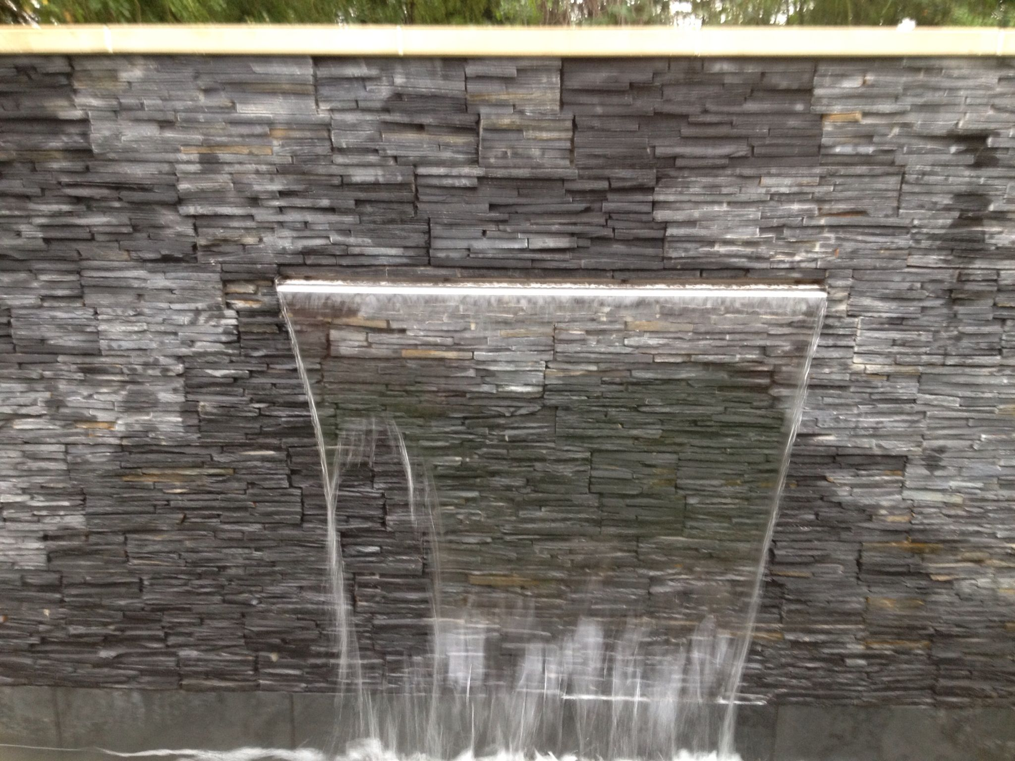 Sheer Descent, Water Feature Wall With Tier Stone Cladding.