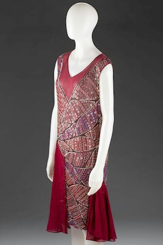 Crimson georgette dress with sequins and silver metallic rings, worn by Greek migrant Lili Sigalas in Melbourne in the 1920s. This 'flapper' dress is representative of this affluent social life and the taste for French couture which could be obtained in select Melbourne stores.