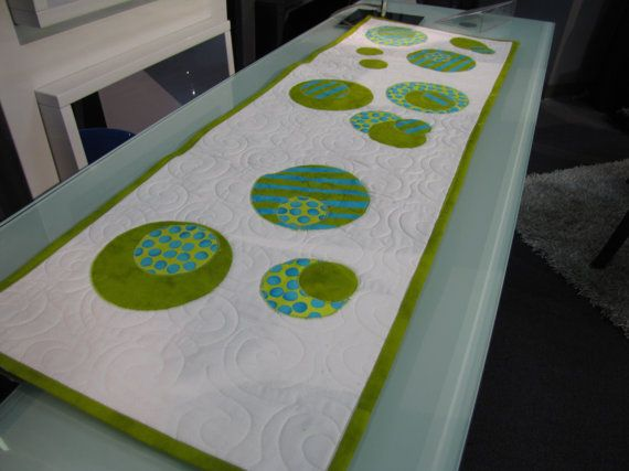 White table runner with green appliquéd by QuiltsbyNancygilmore, $75.00